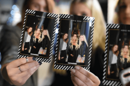 3 women holding up instant printed photos from Mirror Booth Co in Kelowna, an innovative photo booth company for parties and events